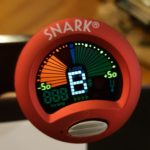 A Snark Tuner showing a flat B note